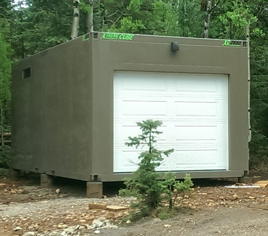 A standalone car garage during install.