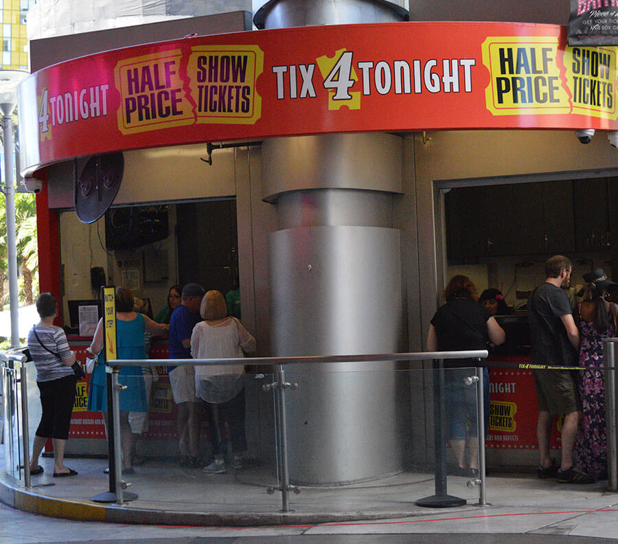 Standalone Xtreme Cube with counter-style window for ticket sales built around existing pillar.