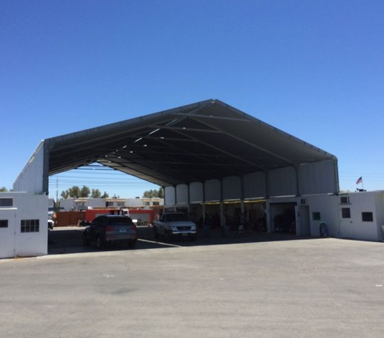 The roof provides shelter from weather conditions and creates a dedicated workspace for service and maintenance of equipment and vehicles.