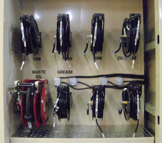 Integrated hose reels ensure the lube dispensary remains organized.