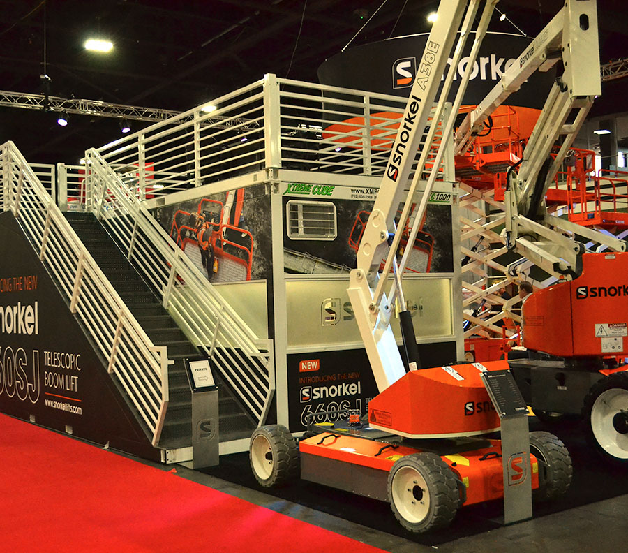 Xtreme Cubes provide private meeting rooms and storage facilities at indoor trade shows. A staircase and upper VIP viewing deck can maximize useful space from a limited booth footprint.