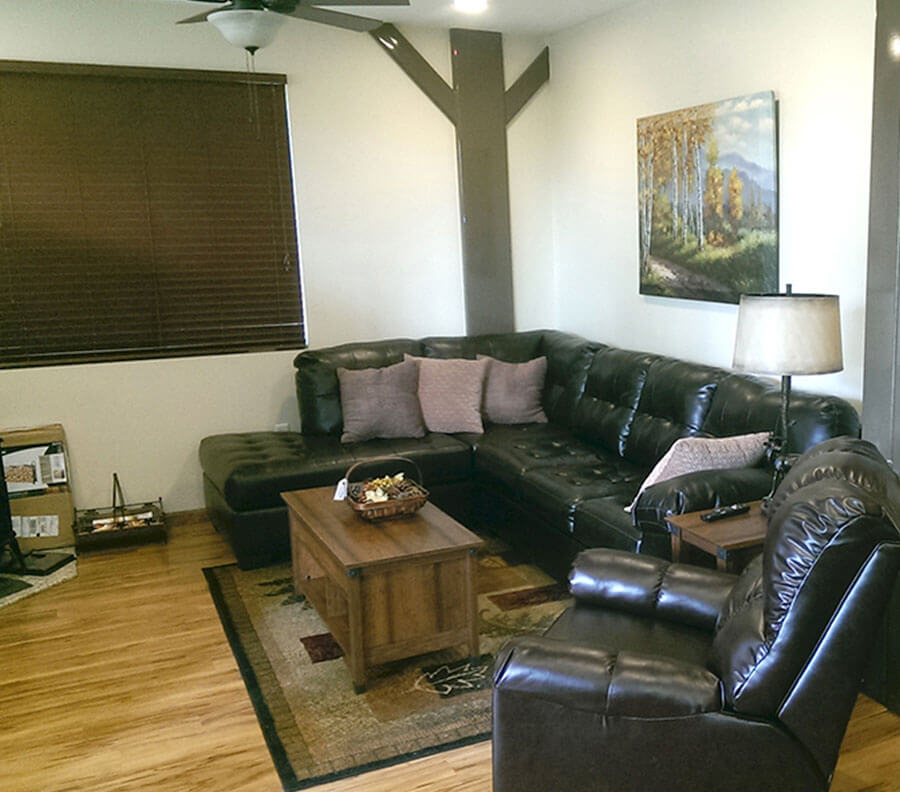 Custom interior with wooden floors and blinds.